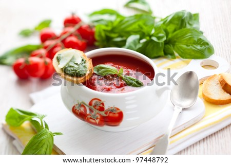 Tomato soup with basil pesto - stock photo