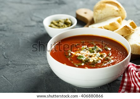 Tomato soup with cheese and pesto sauce - stock photo