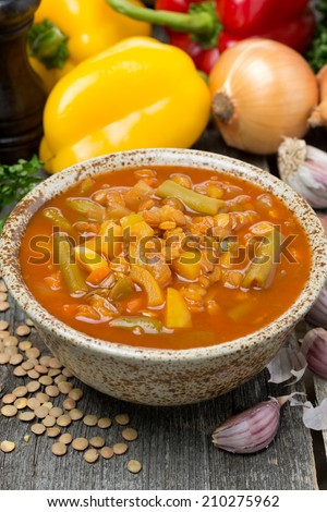 tomato soup with lentils and vegetables, vertical, close-up - stock photo
