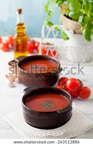 Tomato soup with olive oil and basil. Vegetarian food. - stock photo