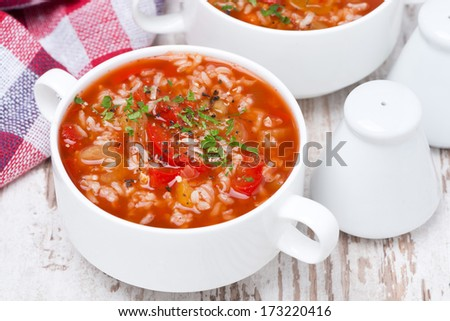 tomato soup with rice and vegetables in a bowl, top view, horizontal - stock photo