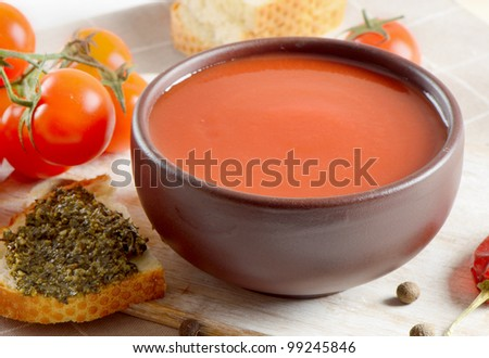 Tomato soup with tomatoes and bread - stock photo