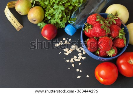 Tomato, strawberry, dill, bottle of water and tape measure, Healthy food concept. Diet concept.  - stock photo