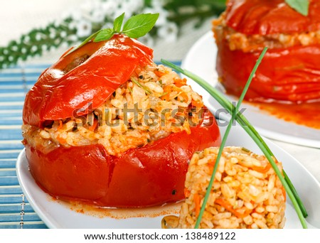 Tomato stuffed with rice and herbs close-up. - stock photo