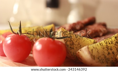 tomato with Baked potatoes and meat - stock photo