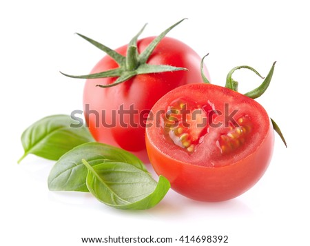 Tomato with basil leaves - stock photo