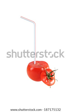 Tomato with drinking straw isolated on white.