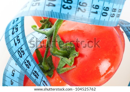 tomato with measurement isolated on white