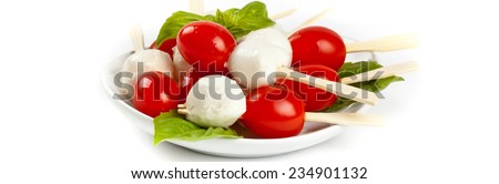 Tomato with Mozzarella and Basil on white background. Panoramic image. Selective focus. - stock photo