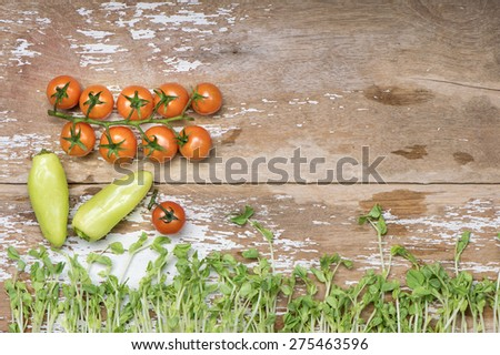 Tomato with Pea sprout and Banana spice wood top - stock photo