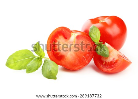 Tomatoes and basil leaves isolated on white - stock photo