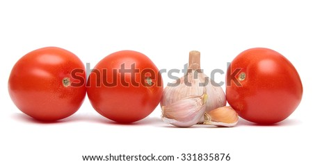 tomatoes and garlic. Vegetables isolated on a white background. - stock photo