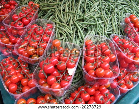 Tomatoes and green beans at farmers market - stock photo