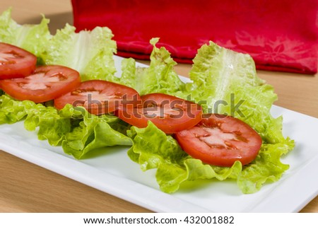 Tomatoes and lettuce leaves.