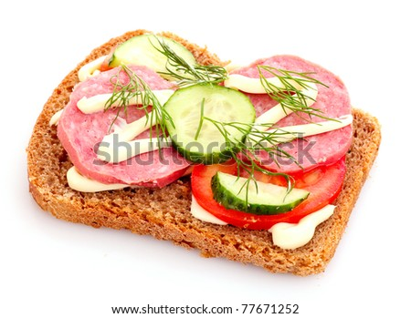 tomatoes and sausage on bread isolated on white - stock photo