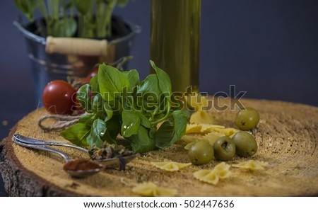 tomatoes, basil and spices on dark grunge backdrop