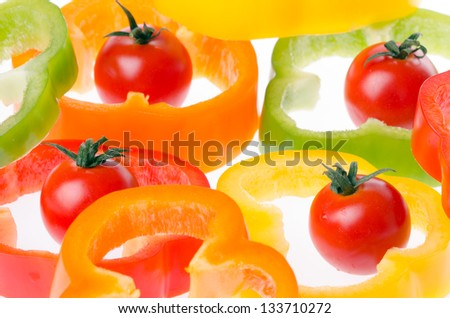 tomatoes cherry with a sliced red,green and yellow pepper