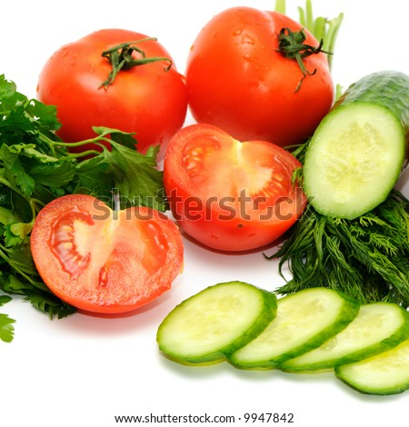 Tomatoes, cucumber and parsley isolated on a white background