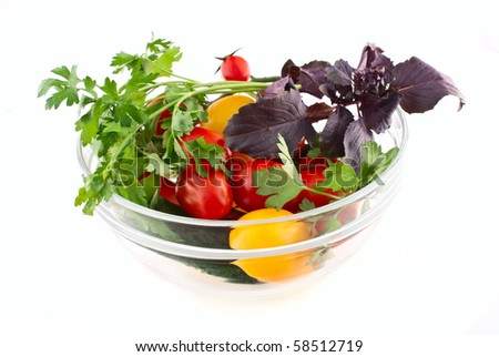 tomatoes, cucumbers, parsley, basil on a white background