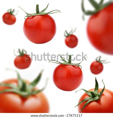 Tomatoes falling down. - stock photo