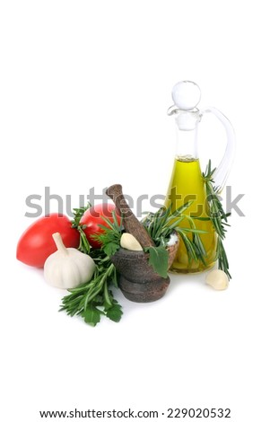 Tomatoes, garlic, olive oil and fresh spicy herbs for sauce preparation on white background - stock photo