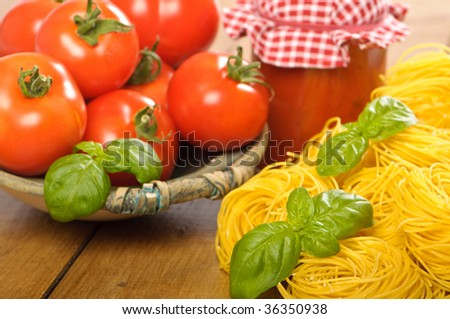 Tomatoes in a rustic bowl with pasta and bolognaise sauce - stock photo