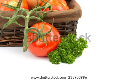 tomatoes in basket on white background