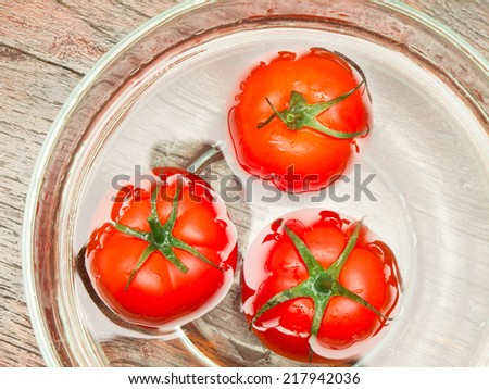 tomatoes in bowl on table  - stock photo