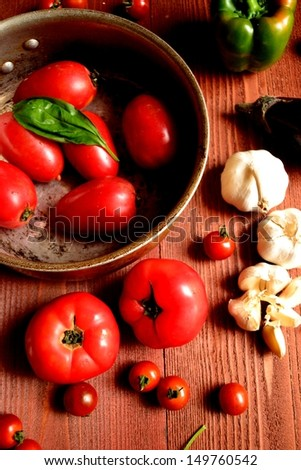 Tomatoes in the pot. vegetables  and herbs.image of Italian food.