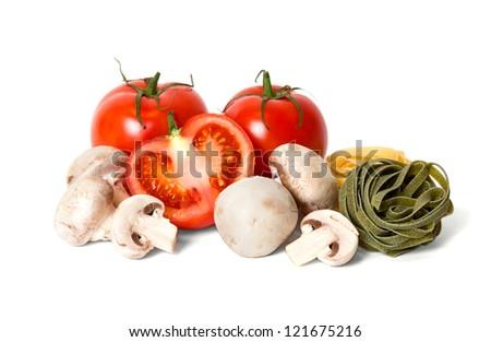 Tomatoes, mushrooms and italian tagliatelle pasta - stock photo