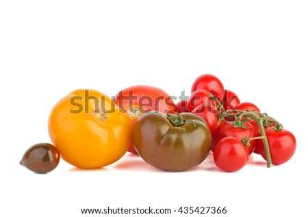 Tomatoes of different breed isolated on white background - stock photo