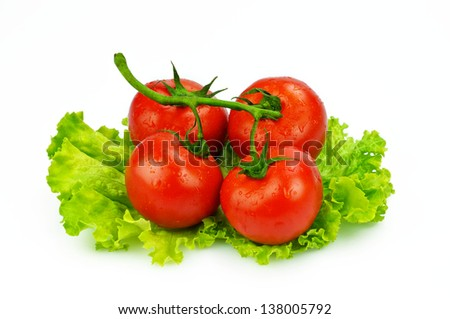 Tomatoes on a salad bed isolated on white background