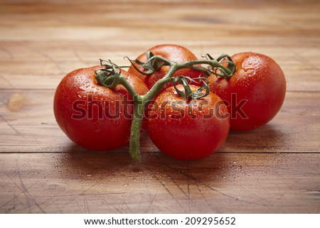 tomatoes on a wooden table - stock photo