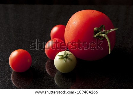 Tomatoes on Black Marble - stock photo