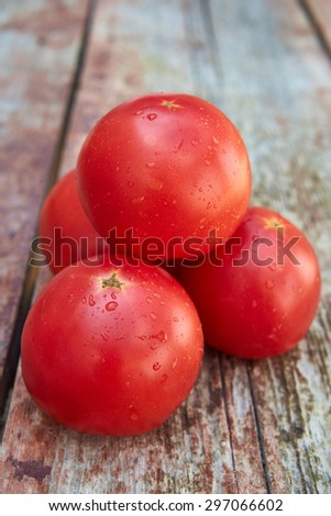 Tomatoes on the wooden  - stock photo