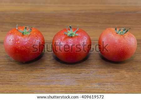 Tomatoes on the wooden background./ Tomatoes - stock photo