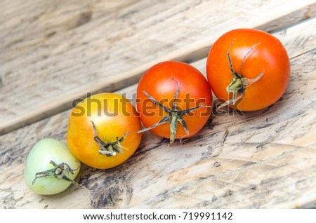 Tomatoes on wooden shelf, rustic
