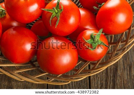 Tomatoes on wooden surface. Selective focus