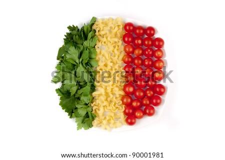 tomatoes, pasta and herb like symbol Italian flag - stock photo