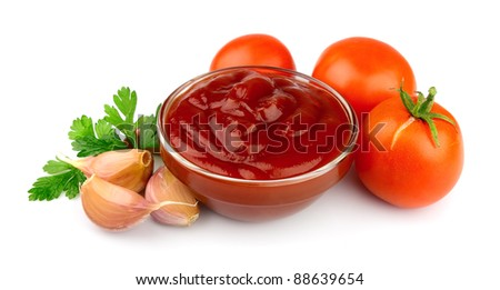 Tomatoes paste with spices and greens - stock photo