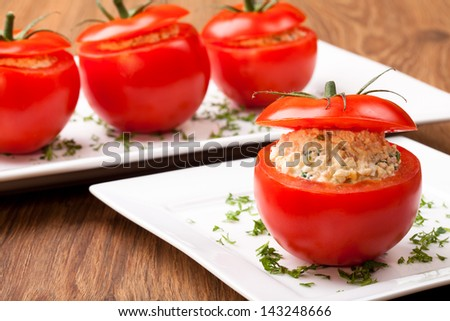 Tomatoes stuffed with ham egg and mayonnaise, decorated with parsley and/or lettuce