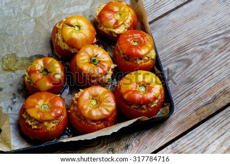tomatoes stuffed with rice and baked in the oven - stock photo