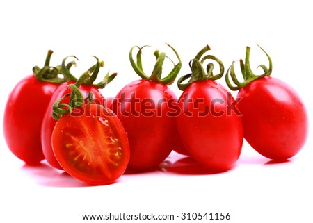 Tomatoes. Whole and a half isolated on white - stock photo
