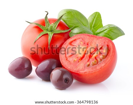 Tomatoes with basil and olives - stock photo