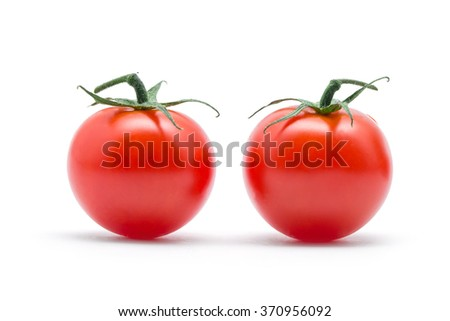 tomatoes with green leaves isolated on white background - stock photo