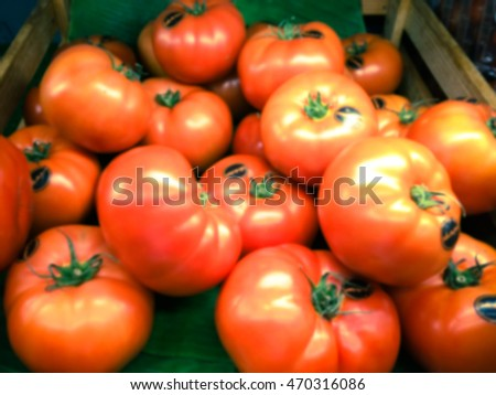 tomatos are in the storeswith blur background