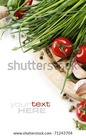 Tomatos, chives, peppers and garlic on white background. With sample text - stock photo