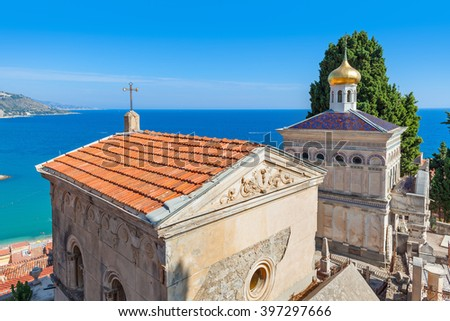 Tomb and small orthodox church on old cemetery of Menton with view on Mediterranean sea on French Riviera. - stock photo
