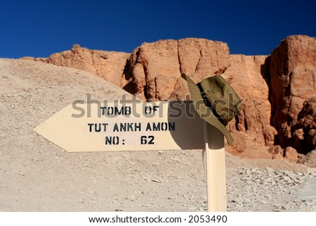 Tomb of Tut sign in Valley of The Kings with explorer Hat - stock photo