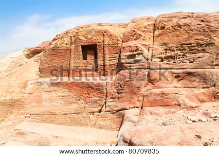 Tombs made by digging a holes in the rocks during  Roman Empire period. Petra- Nabataeans capital city,  Jordan. - stock photo